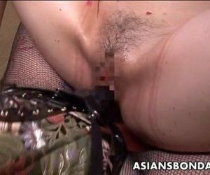 Tattooed up Asian domina strap on fucking the sub - 8 min