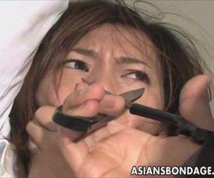 Cute Asian babe in electro play bondage scene - 7 min