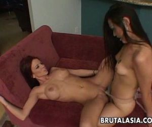 Asian and regular lesbo bitches fucking with a strap on -..