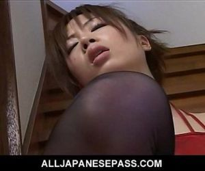Sexy Japanese slut fingers and toys her pussy on the steps..