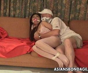 Asian slut is getting roped up and treated to a bdsm..