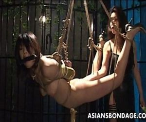 Bound Asian chick endures a nasty BDSM threesome - 8 min