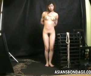 Bound Asian gets treated to a bdsm rope session - 10 min