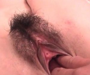 Teen jap seductress pleasured in her hairy muff with..