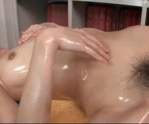 Sara Seori oils up her body and fingers her pussy - 5 min