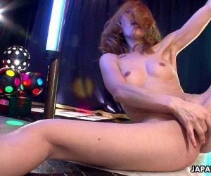 Asian stripper getting wild on the pole as she masturbates..
