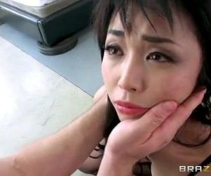 Marica Hase is on her knees sucking his prick with no..