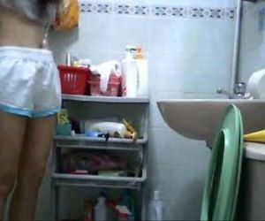 Hiddencam young girl in toilet - 55 sec