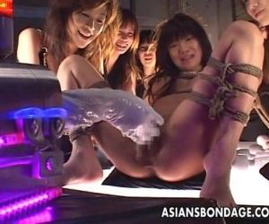 Tied up Asian babe gets fucked with a machine - 8 min