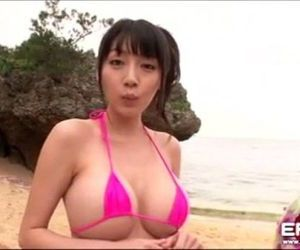 Busty Asian girl went to the beach with her new boyfriend..